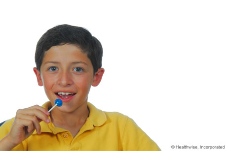 Person getting quick sugar from a lollipop